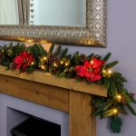 1.8m Outdoor Green Battery Pre Lit Garland with Red Poinsettias